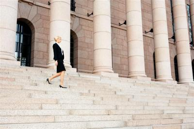 Business-Woman-Walking-Stairs-Building